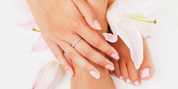 manicure-pedicure-with-flower-lily-close-up-isolated-on-white-picture-id489146942